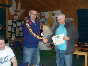 M Tweedy receiving his certificate