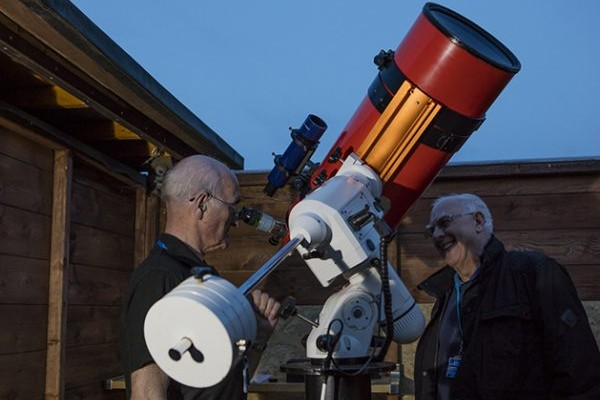 Dave Tatters (left) and Stewart Hepton (right) of Sunderland Astronomical Society inspect the newly-refurbished Grubb-Parsons Perseus. Te;lescope